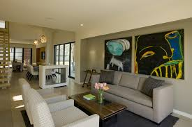 living room awesome living room decorate with white fabric dotted sofa and grey fabric couches also wooden table and strip coushin and abstract painting awesome living room design