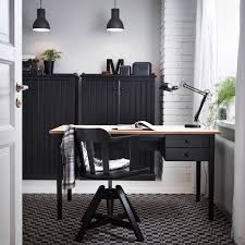 awesome two toned oak wood desk double pull out drawers black painted wooden swivel chair cool patterned rug twin black pendant lamp white brick wall awesome black painted