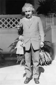 albert einstein holding an albert einstein puppet circa  einstein puppet