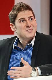 Facebook co-founder Eduardo Saverin speaks during the Wall Street Journal Unleashing Innovation executive conference held at Capella Singapore. - eduardo-saverin-450