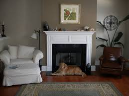 living room adorable living room with fireplace and tv on opposite walls teddy and the fireplace plus white fabric armchair also white fireplace mantel adorable living room