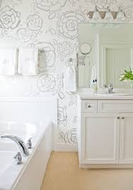 bathroom features gray shaker vanity: stunning bathroom features modern floral wallpaper oh joy petal pusher wallpaper framing triple sconce illuminating mirror over white shaker cabinets
