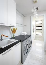black countertops pendant lighting and laundry rooms on pinterest bright modern laundry room