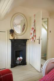 big master bedrooms couch bedroom fireplace: oh this would be lovely to put the mirror and a fireplace across from the bed in our atttic room lavender cottage in country homes and interiors
