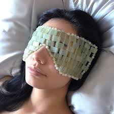 Try a <b>jade eye mask</b> to help with puffiness | Well+Good