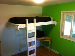 space saving kids room design showing white wooden floating loft bed with stairs and brown unfinished bunk beds casa kids