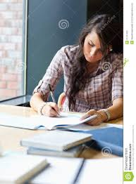 portrait of a beautiful student writing an essay stock photography  portrait of a beautiful student writing an essay