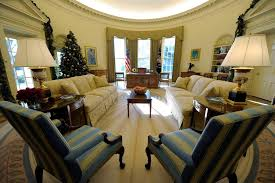 presidents office takes on new neutral tones but keeps its familiar shape bill clinton oval office rug