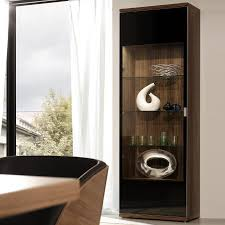 dark brown wooden display cabinet framed