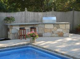 patio outdoor stone kitchen bar: outdoor stone kitchen comes from a kit