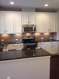 subway tile backsplash brown granite and under cabinet lighting on pinterest cabinet lighting backsplash home