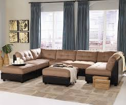 f astonishing furniture for living room decorating ideas presenting tan tufted fabric and black leather u shaped sectional sleeper sofa also equipped two astonishing living room furniture sets elegant