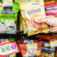 <b>hand</b> of woman choosing or taking sweet products, <b>snacks</b> on shelv ...