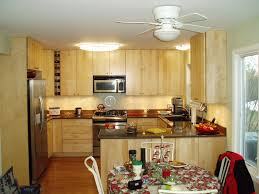 Small Space Kitchen Appliances Designing Small Kitchens With Simple Wooden Cabinet And Round