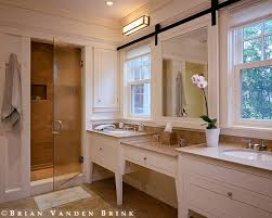 sliding bathroom mirror: windows in front of bath vanity sinks note how the mirror is mounted on a