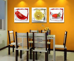 dining room wall decorating ideas: orange accent wall for small dining room decorating ideas with fruit wall decor