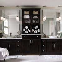 bathroom cabinets designs dark cabinets by homecrest in a bathroom designed with purpose