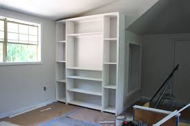 how to build inexpensive built ins using pre made stock cabinets and standard size plywood build living room built ins