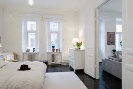 apartment cozy bedroom design: it was a good idea to choose white for this lovely apartment it highlights its modern elements and gives the feeling of a bright and airy space