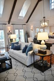 cozy neutral living room with high ceilings pops of blue casual living room lots