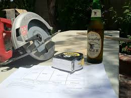 hand saw measuring tape and an ice cold yuengling lager front shot finished vinyl record
