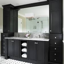 black bathroom cabinets with white and grey counter top and black and white floor tiles black and white bathroom furniture