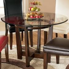 ashley furniture kitchen tables: signature design by ashley charrell round glass top table item number d