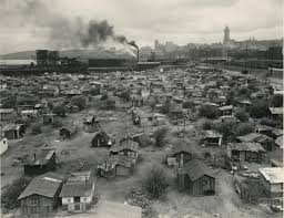 the lived experience of the great depression us history ii a series of small wooden structures on the outskirts of a city