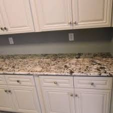 bianco antico granite with wooden cabinet and wooden floor also lighting lamp for modern kitchen decor cabinet and lighting