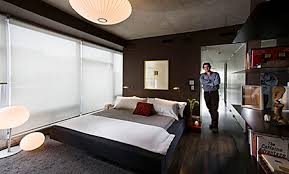 in this photograph chicago artist lincoln schatz stands in the doorway of the master bedroom bachelor pad ideas