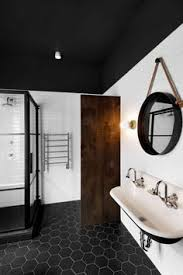 wan spot light seen in this renovated house from 1910 in montreal canada by emilie black bathroom lighting