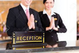 chinese asian reception team at luxury hotel front desk welcoming chinese asian reception team at luxury hotel front desk welcoming guests typical gesture a