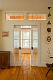 home office doors with glass. farmhouse home office by phinney design group like the wavy glass pocket doors for officelibrary with