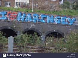 iron wall cross love: huge graffiti saying i love haringey on wall beside railway line out of kings