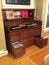 solid walnut record storage and turntable cabinet can hold approximately 1000 lps lid opens up to reveal turntables and mixers and audio equipment front shot finished vinyl record