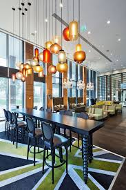 enticing dining room with glass modern pendant lighting above enthralling colorful black rectangle wooden table awesome sample pendant lights bathroom