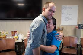 midlanders of the year the nebraska ebola team omaha com patient no 2 ashoka mukpo gets a farewell hug from morgan shradar a biocontainment unit nurse upon his release from the facility on oct 22