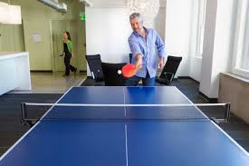 kinds of annoying co workers and how to deal them careers man playing ping pong at work