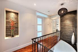 wall alcove decorating ideas hall modern with tumbled stone metal spindles wood railing alcove lighting ideas