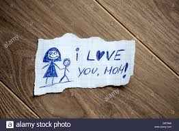 love written on paper stock photos love written on paper stock i love you mom written on piece of paper on a wood background