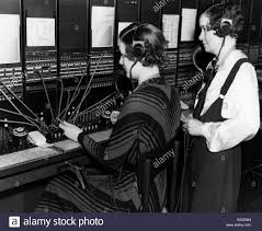 1930s female telephone switchboard operator and supervisor stock 1930s female telephone switchboard operator and supervisor