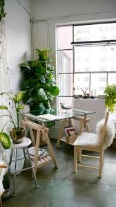 right off to ikea very cool workspace love the fiddle leaf fig broadway green office furniture