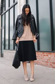 13 stylish and professional outfits to wear on a job interview interview outfit idea camel sweater midi skirt leather jacket andy heart