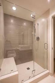 this modern bathroom has a large glass enclosed shower in tile the shower stall bathroom shower lighting ideas