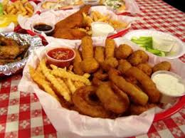 Fried food items, in the basket with side sauces