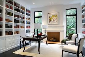 home office in a spanish revival home with white built in bookshelf traditional wood desk black white home office cococozy 5