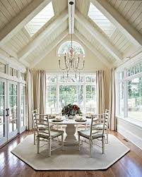 living room carolina design associates: i may want a few painted beams in between our skylights you are surrounded by light in this dining room by carolina design associates