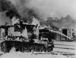 great depression american social policy social welfare history shacks put up by the bonus army on the anacostia flats washington d c burning after the battle the military the capitol in the background 1932