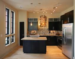 lighting in the kitchen will help with prep and cooking processes and layered lighting with accent ambient and ambient track lighting