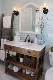 country themed reclaimed wood bathroom storage: cozy brown linens paired with icy blue walls note the colors for guest bathroom vanities mirrorrustic